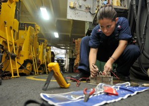 110723-N-EE987-125 GULF OF ADEN (July 23, 2011) ElectricianÕs Mate 2nd Class Maria Arreedondo, from Houston, uses a flow divider while fixing a forklift battery charging station in the hangar bay of the aircraft carrier USS Ronald Reagan (CVN 76). Ronald Reagan is conducting operations supporting maritime security operations and theater security cooperation efforts in the U.S. 5th Fleet area of responsibility. (U.S. Navy photo by Mass Communication Specialist 3rd Class Shawn J. Stewart/Released)